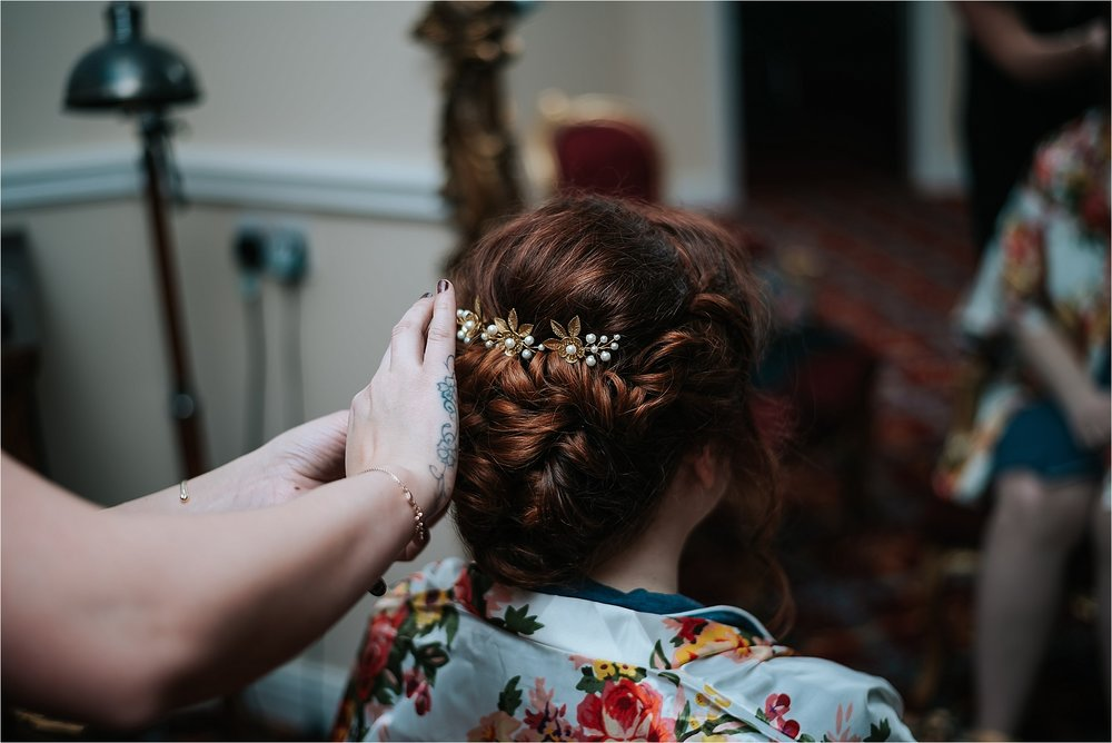 bride has hair done ready for wedding