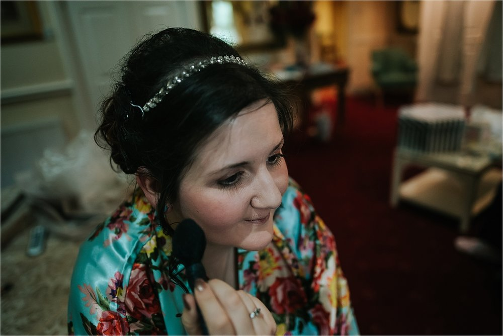bridesmaid does make up at wedding venue in lake district