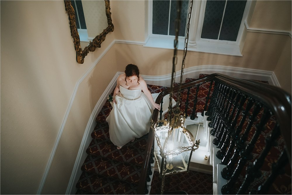 bride walks down the stairs at the grange hotel