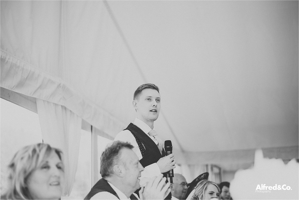 groom doing speeches