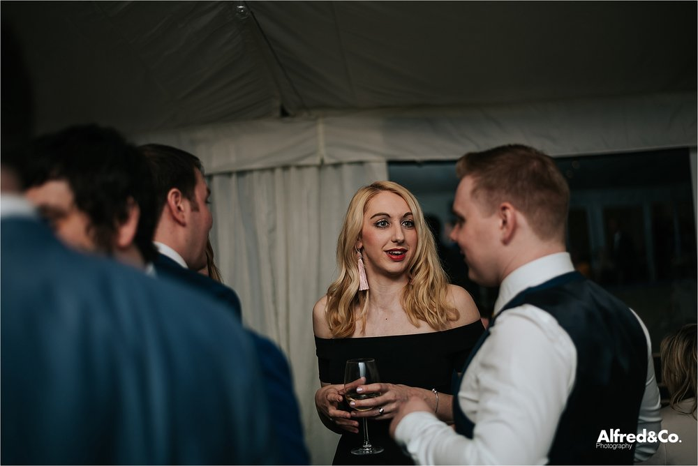 guests enjoying the evening reception at speke hall wedding pavilion