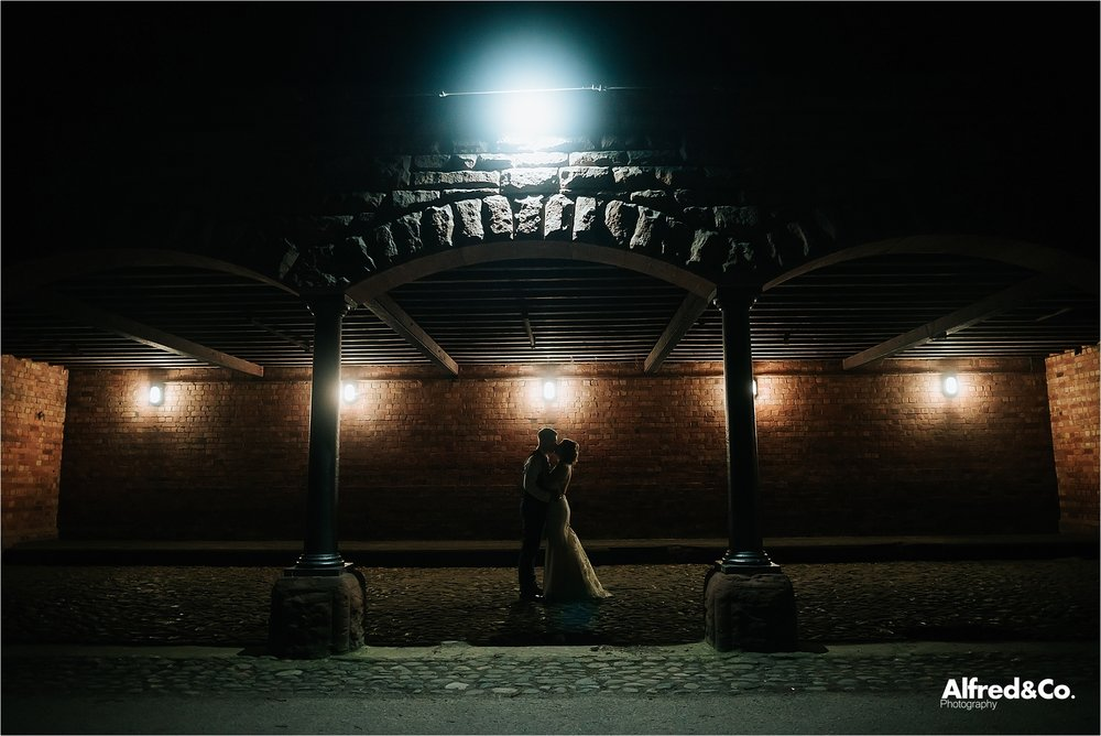 night time shot of bride and groom at speke hall