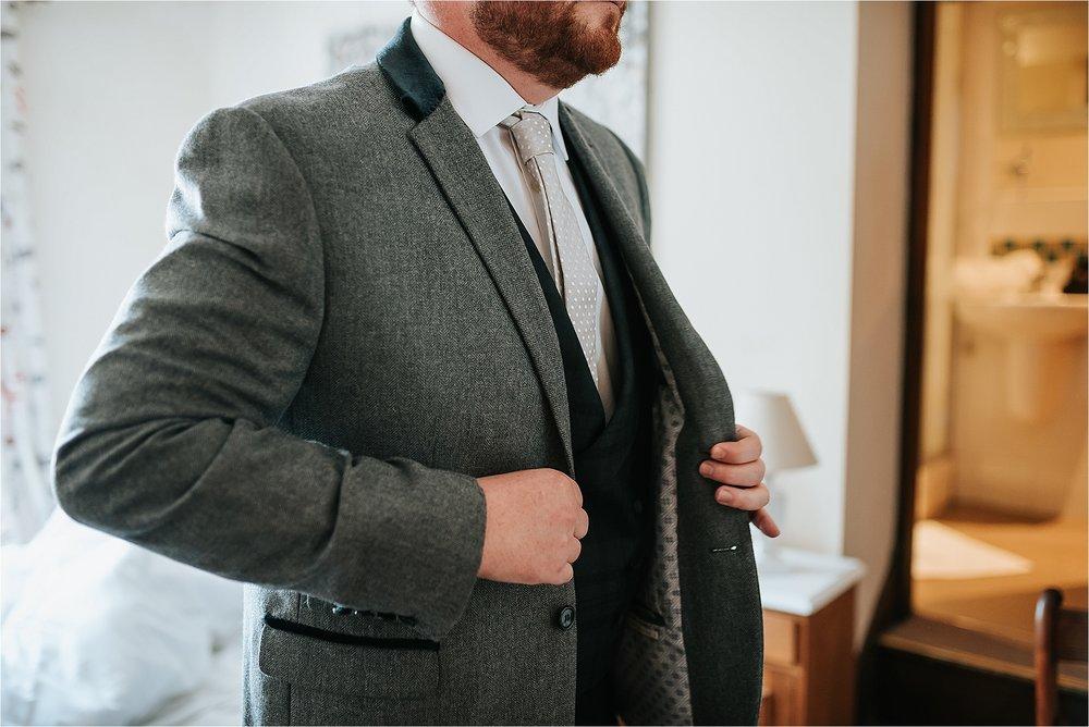 groom gets dressed