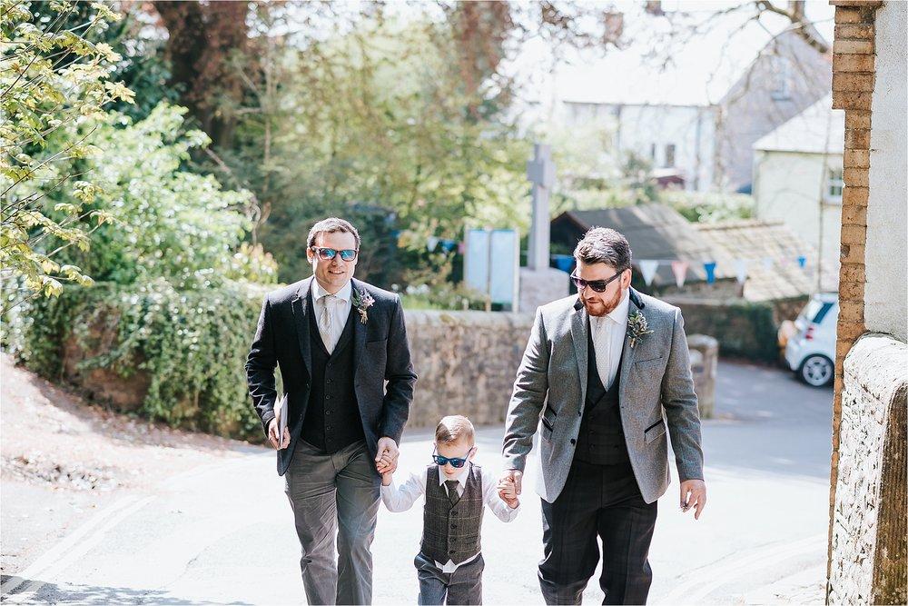groom and groomsmen arrive at church