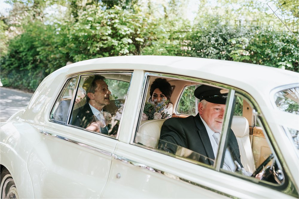 bride arrives in wedding car