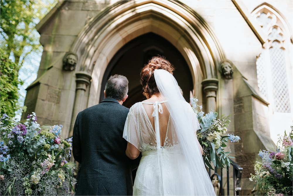 dad and bride outside church in scorton waiting to go in