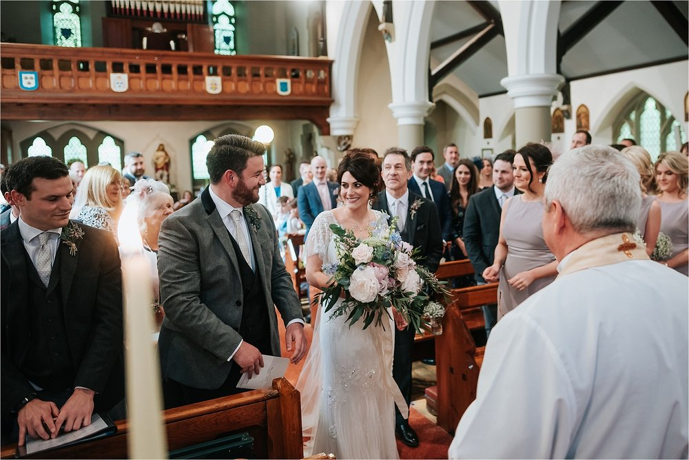 bride and groom inside church