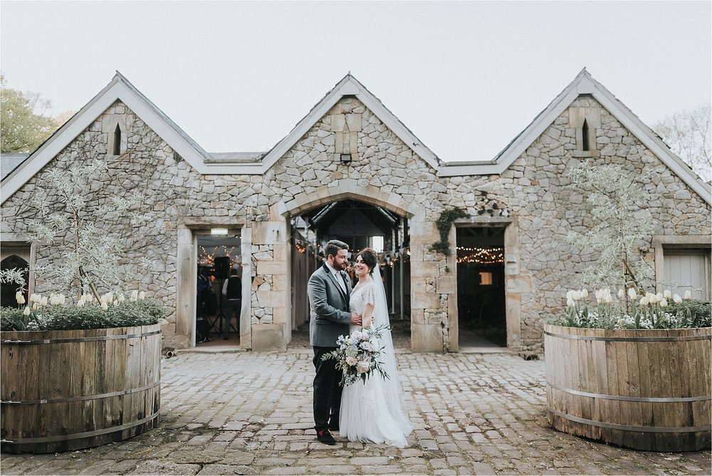 bride and groom outside wyresdale park wedding barn