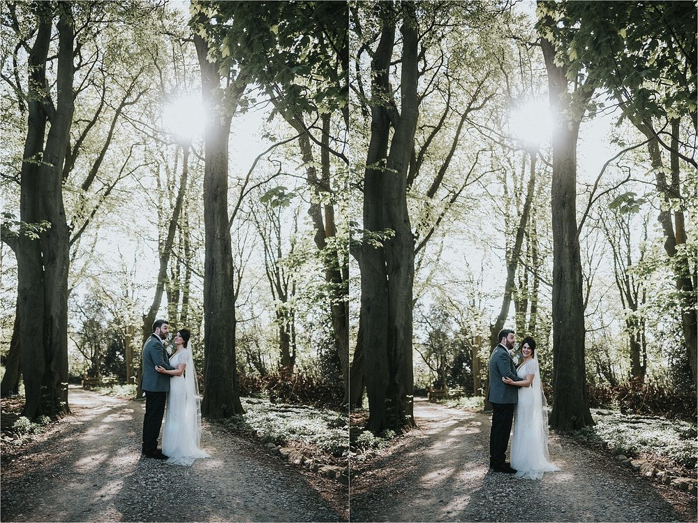 bride and groom in woodland surrounding wyresdale park