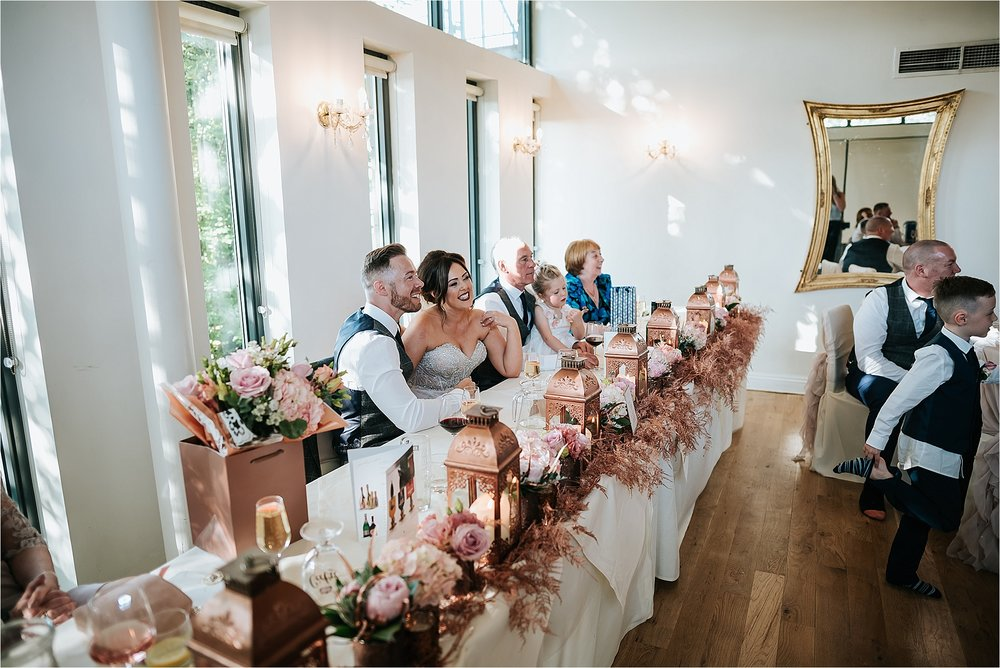 bride and groom in wedding breakfast room