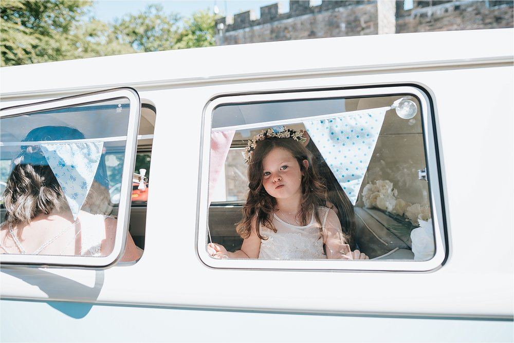 Flower girl inside vintage VW camper van