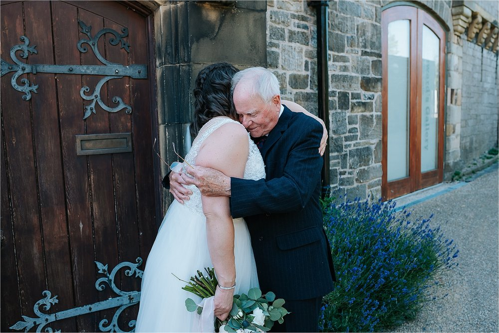 Bride Hugs Grandad at wedding at clitheroe castle