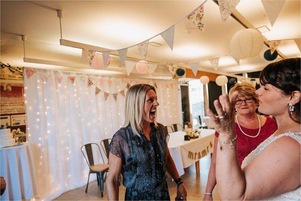 Guest laughing at wedding