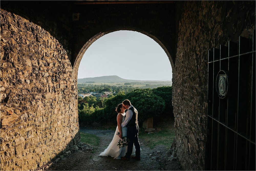 bride and groom with view at clitheroe castle