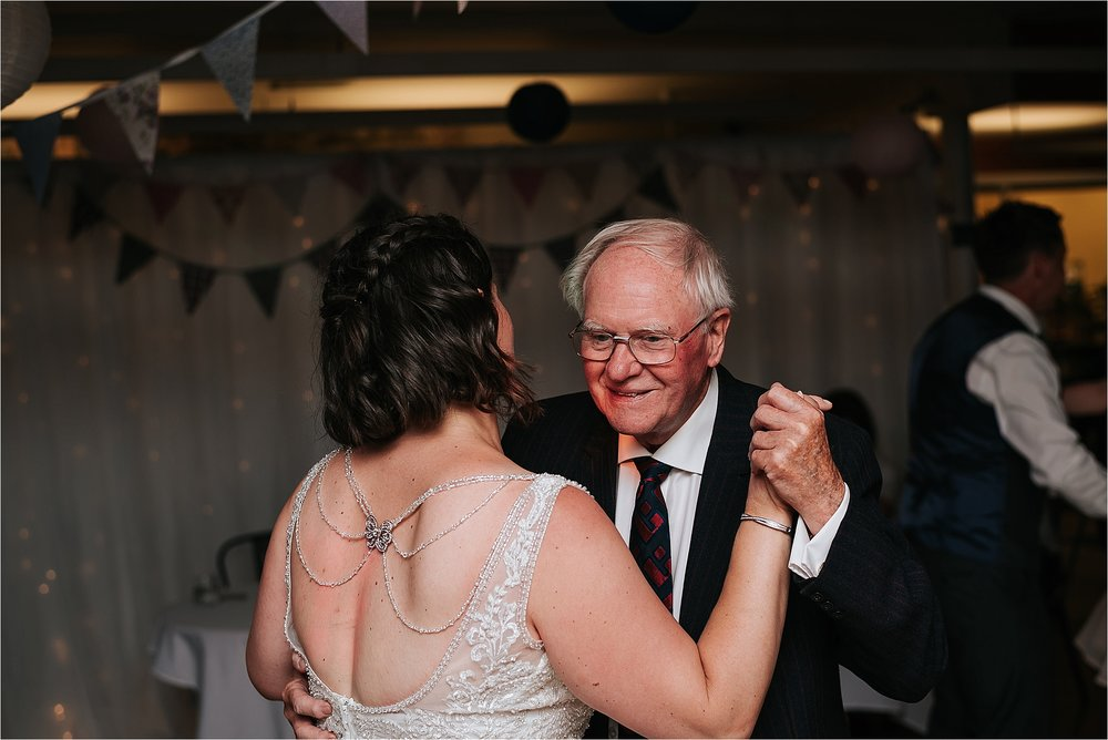 Bride dancing with her grandad