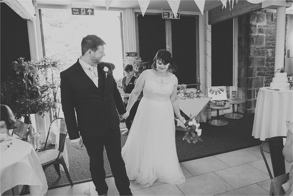 Bride and groom enter the room at the atrium, clitheroe