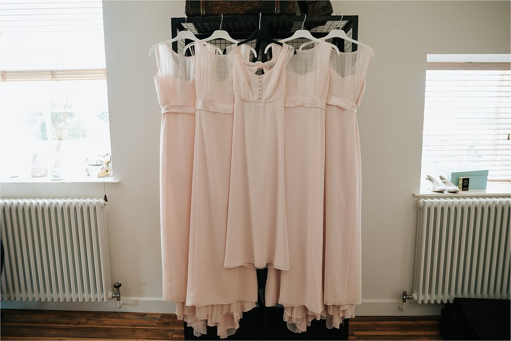 bridesmaids dresses hanging up in the penthouse at the spinning block hotel, clitheroe