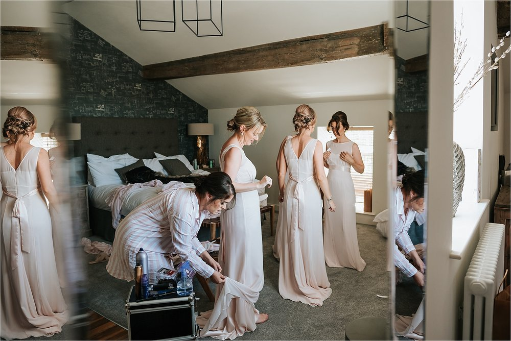 Bridesmaids getting ready in the penthouse at the spinning block