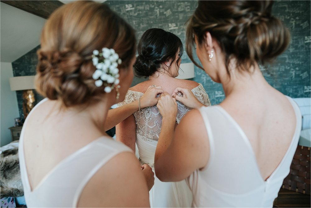 bridesmaids doing wedding dress up at the spinning block at holmes mill