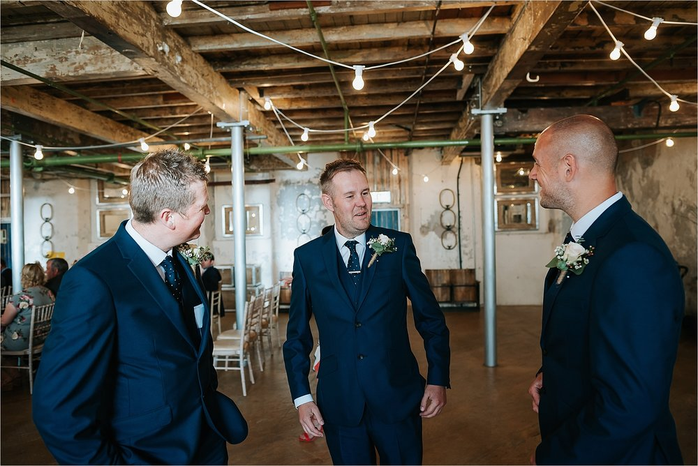 Groom and groomsmen at holmes mill wedding