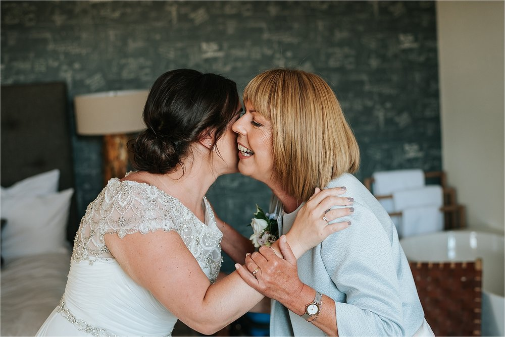 Bride and Mum in the penthouse before wedding at holmes mill