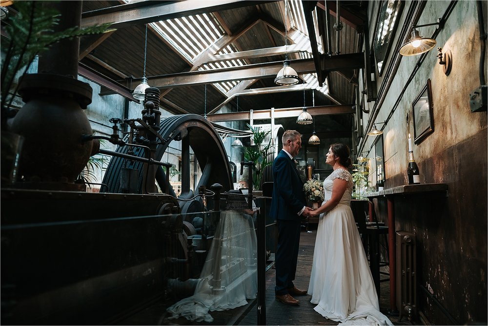 Bride and Groom in Engine Room at Holmes Mill Wedding
