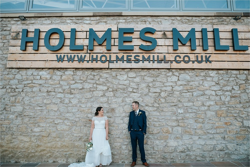 bride and groom outside holmes mill