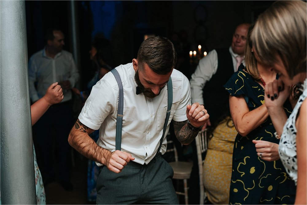 Wedding guests dancing at holmes mill