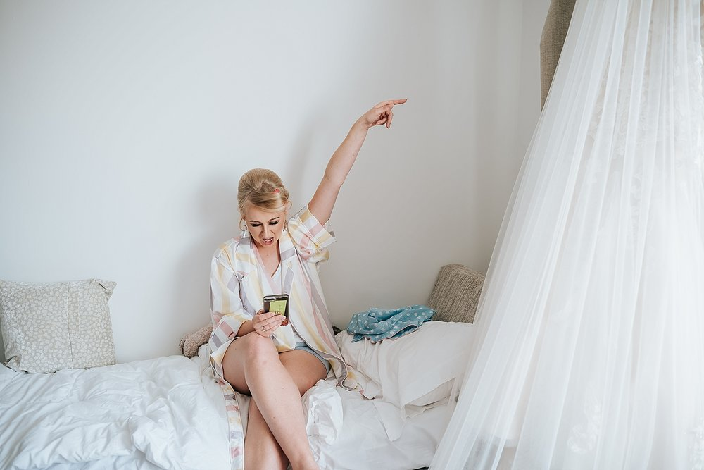 blonde bride in pyjamas before wedding