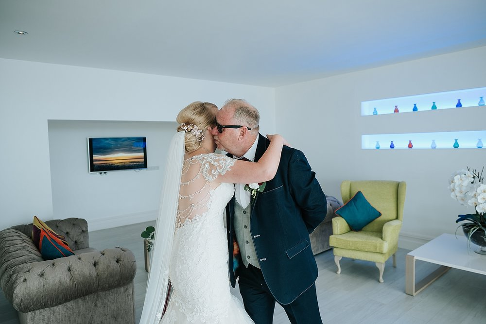 bride hugs dad before wedding at st annes palace