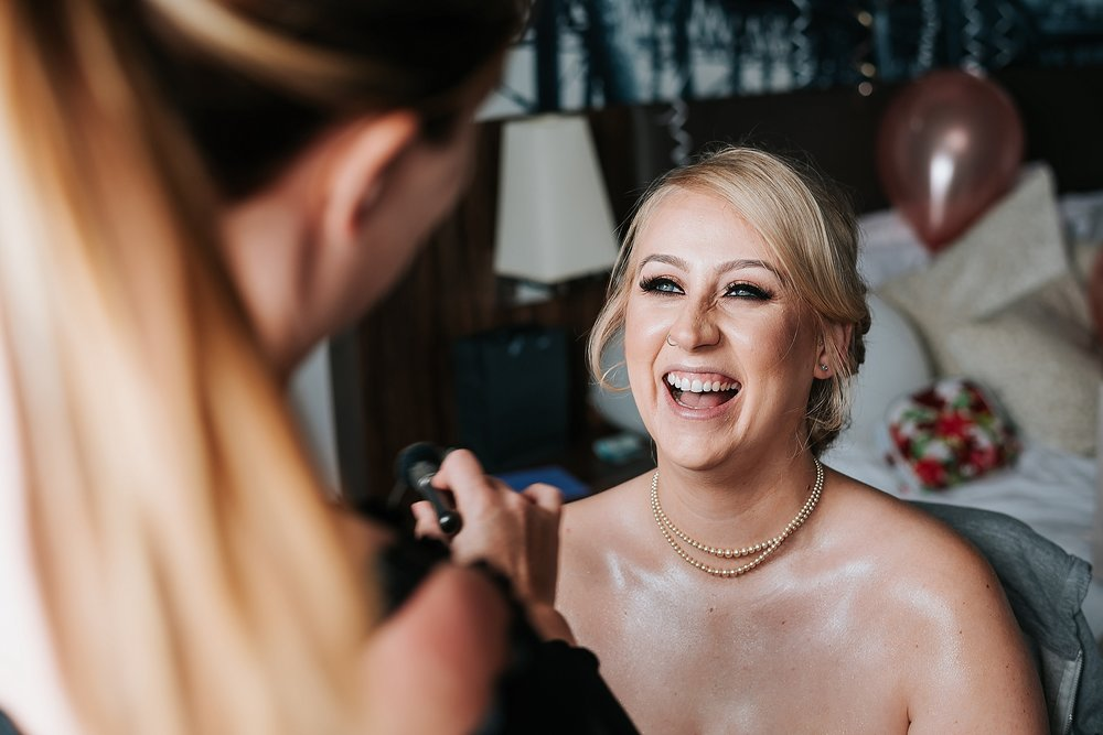 bride having make up done