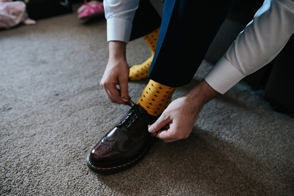 groom puts on his doc martens