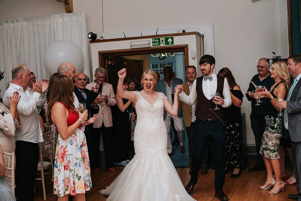 bride and groom take to the floor for their first dance