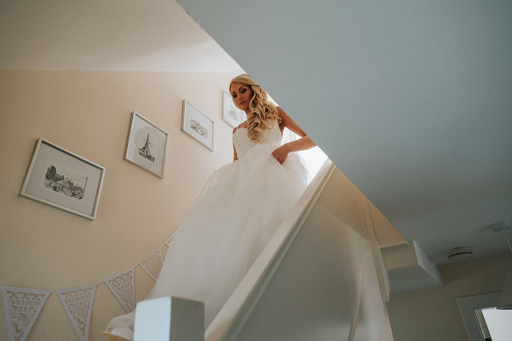 bride walking down stairs before wedding