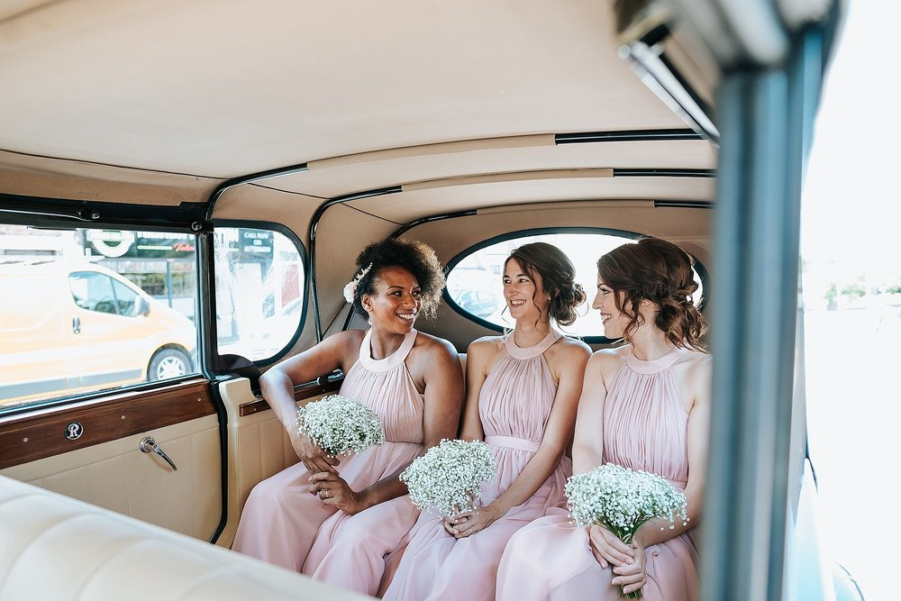 bridesmaids in wedding car