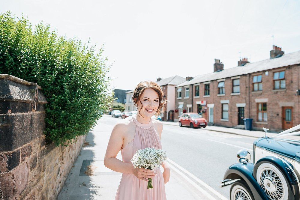 bridesmaid outside all saints church in preston