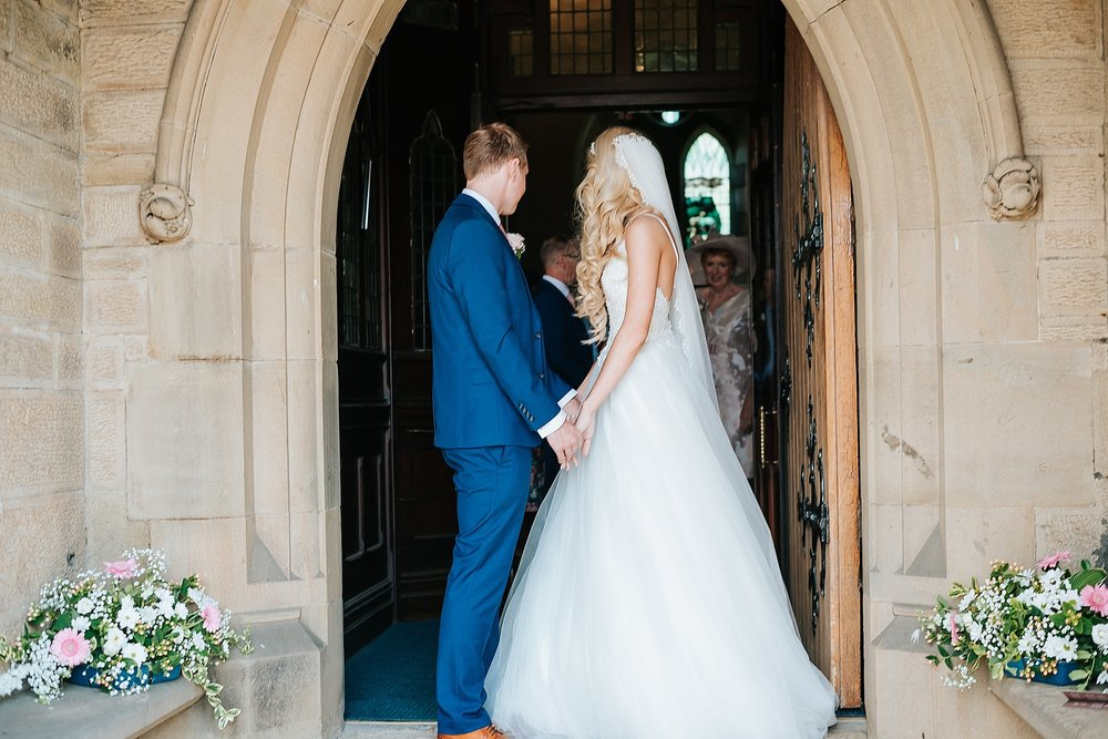 bride and groom leave church in preston
