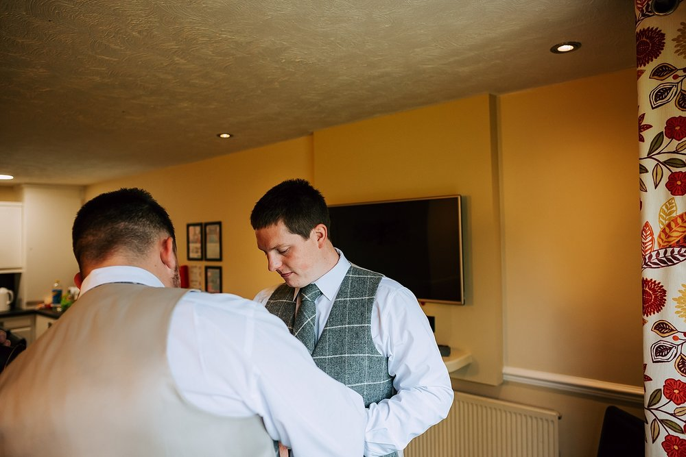 groom getting ready in cottage at ribby hall
