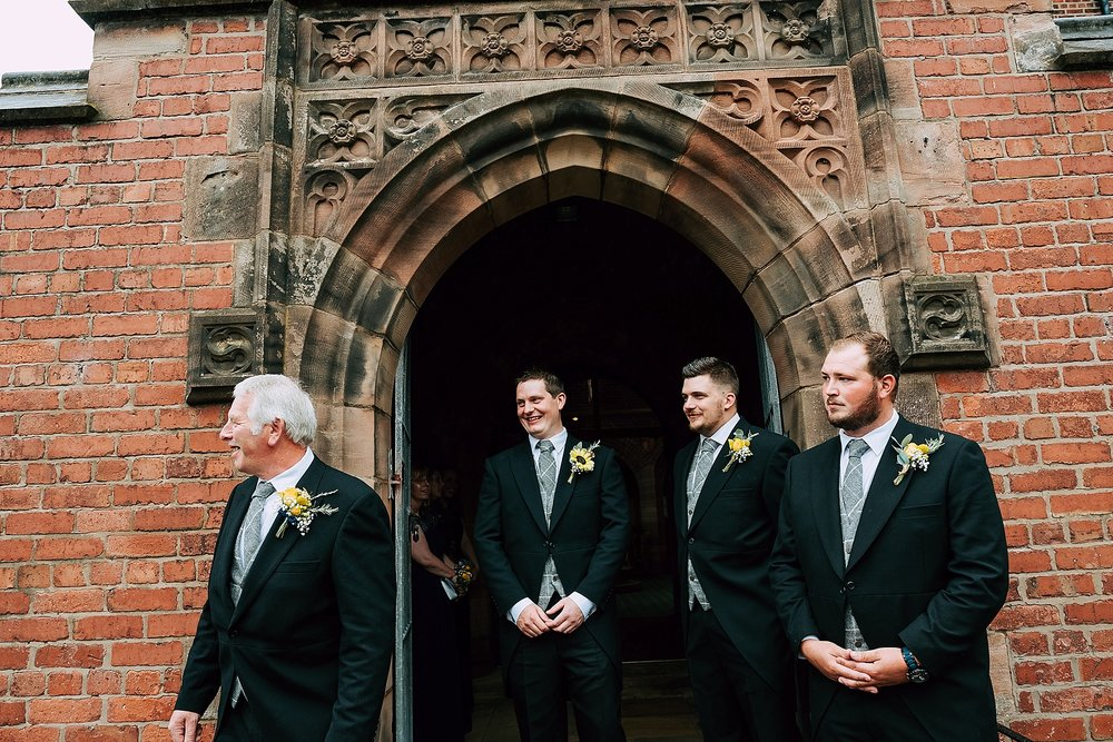groomsmen wait for bride at christ church in wesham