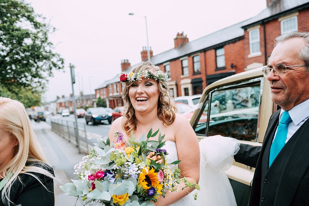 Bride arrives at church with flower crown on head