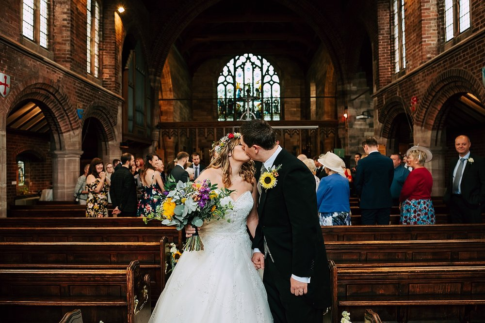 couple walk down aisle at wedding in lancashire