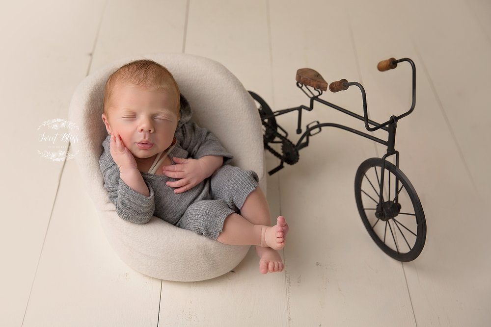 Baltimorenewbornphotographer_harfordcountynewbornphotography_Sweetblissphotography_boychairbike.jpg