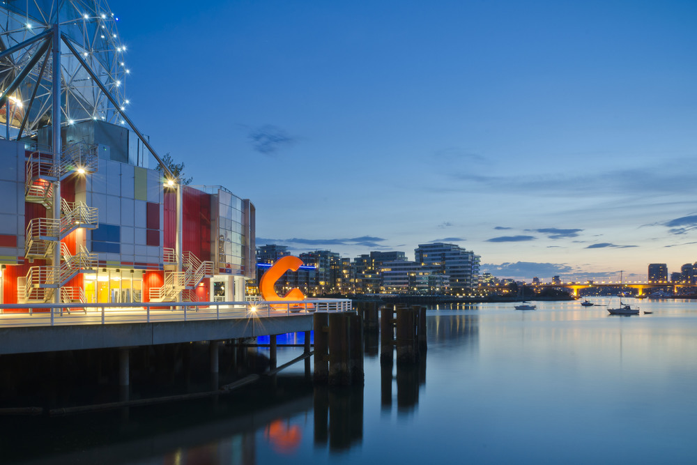 Vancouver's recently renovated Science World and Southeast False Creek at dusk.