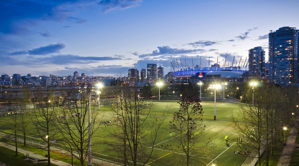 Soccer Pitches with BC Place in the background on a clear night from the rooftop of a Chinatown Parkade Brett Ryan Studios Weekly
