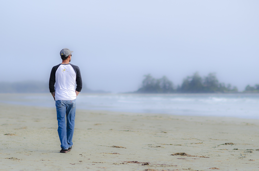 Brent walks along Chesterman Beach, Tofino, Photo by Brett Hitchins