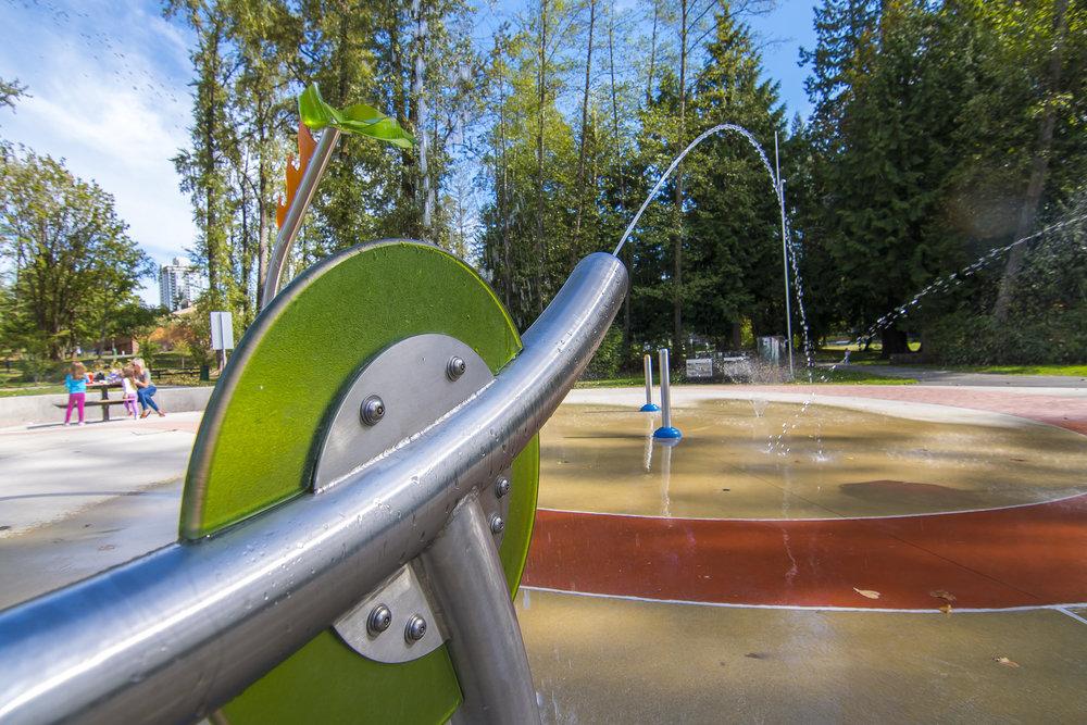 Green water spray guns at splash park