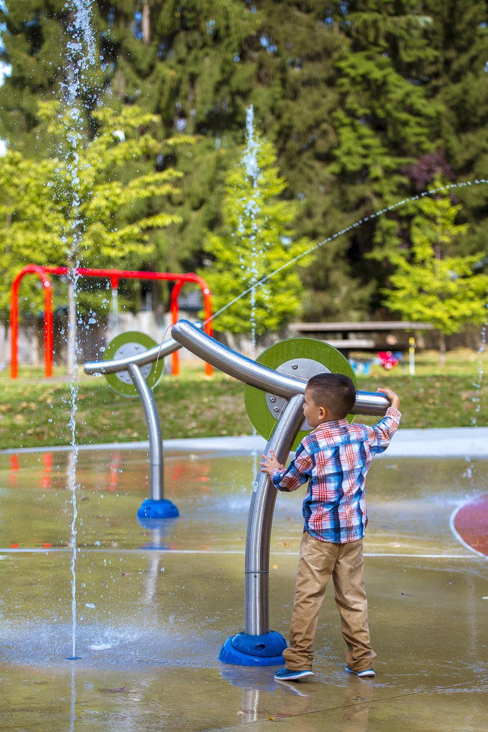 Kid playing in splash park