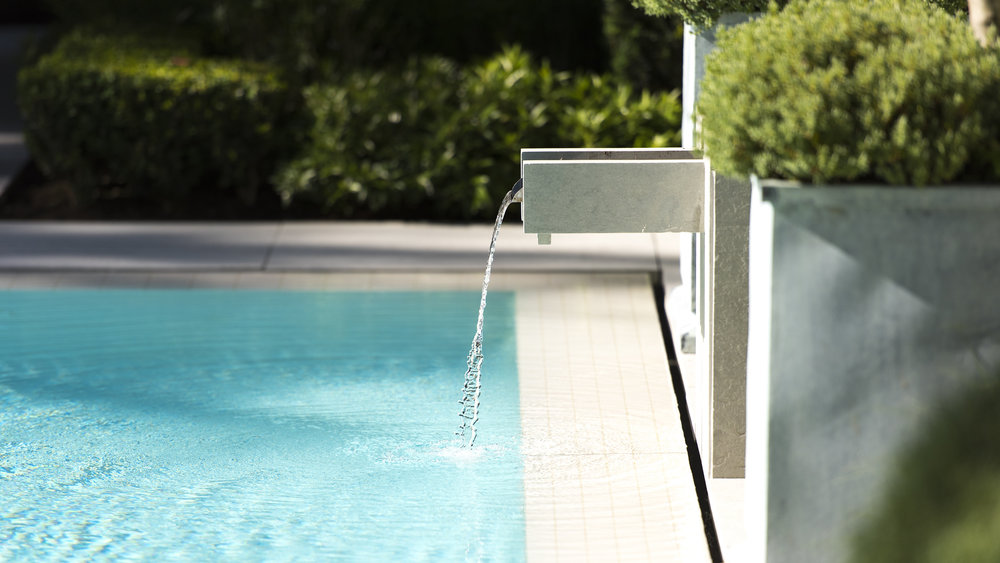 Poolside fountain at Vancouver Home and Garden by Paul Sangha