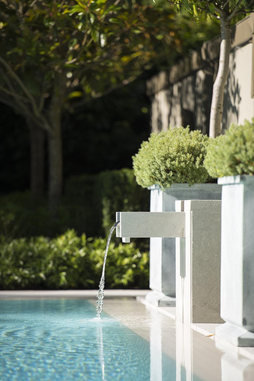 Residential pool water fountain by Paul Sangha
