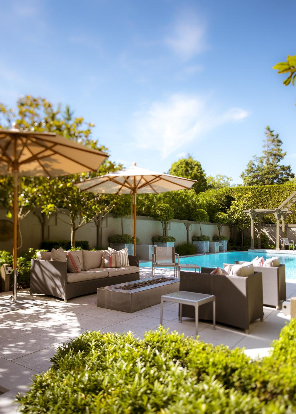 Poolside seating area by Paul Sangha